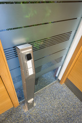 key access control column at modern office building