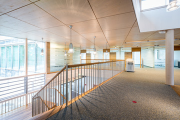 bright wooden lobby hall of modern office building