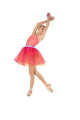 Beautiful young girl ballerina wearing a pink outfit