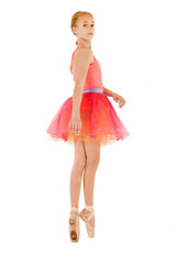 young female ballerina on pointe wearing pink outfit