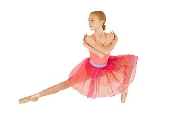 cute young redhead ballerina girl wearing pink tutu