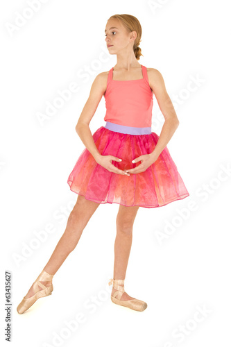 cute young girl ballerina posing wearing a pink tutu