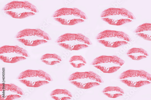 A wallpaper of red kisses of lipstick (background)