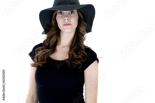 Female model with a serious expression wearing a black top