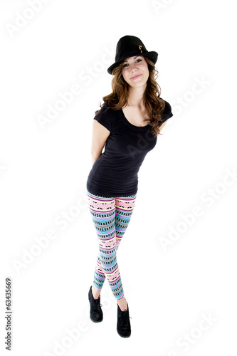 female model wearing heels, cut hat and colorful leggings