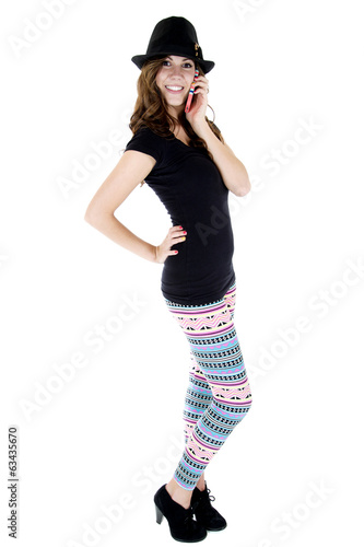 female model talking on her cellphone in colorful leggings