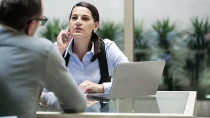 Businesswoman talking with man in the office.