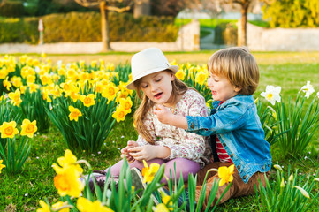 Adorable children playing with flowers