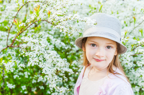 Spring portrait of adorable little girl