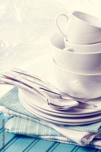 White plates and cups on blue napkins