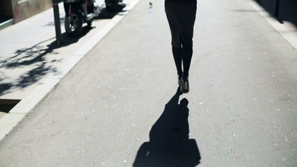 Businesswoman walking on street, steadycam shot