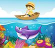 A boy in the ocean with a shark