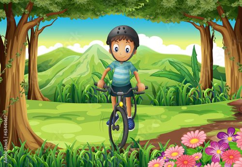 A boy biking at the jungle