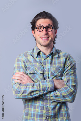 Portrait of funny man in glasses.