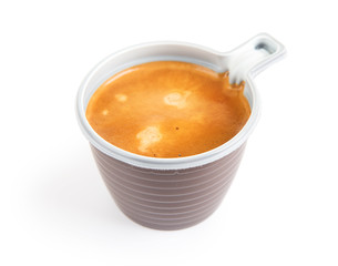 Espresso coffee in a disposable cup on white