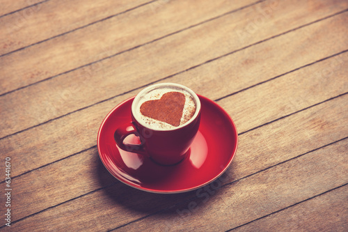 Cup of сoffee on a wooden table.