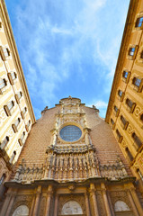 The facade of the Basilica in the Benedictine Montserrat. Spain