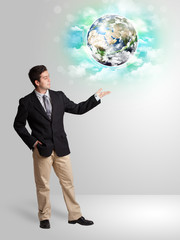 Young man with earth and cloud concept