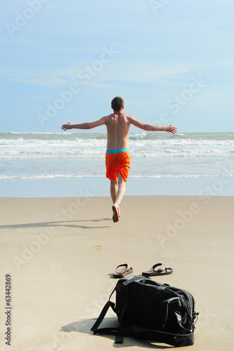 Man runs into the sea