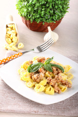 Tortellini with meat sauce and basil