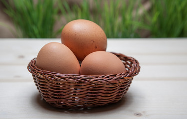 Easter still life with eggs in a basket.