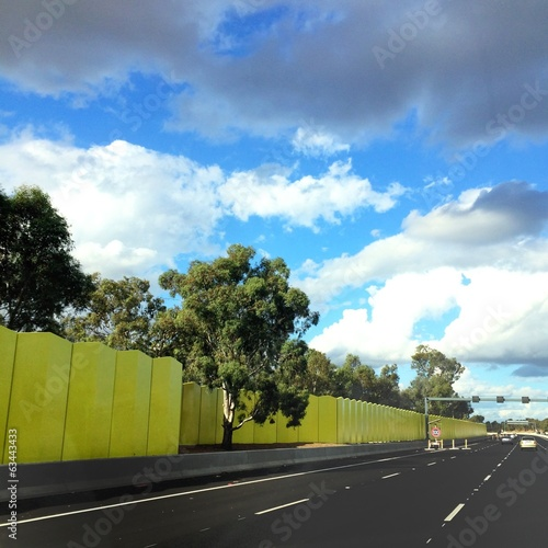 bright green wall next to highway