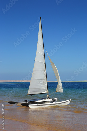sailing catamaran on beach