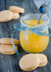A jar of lemon curd with a spoon