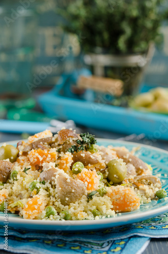 Couscous with mushrooms, vegetables and green olives