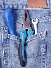 Tools in blue jeans pocket