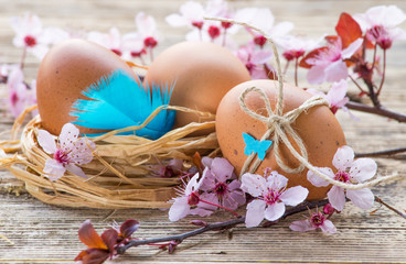 Easter rustic decorated eggs and spring flowers