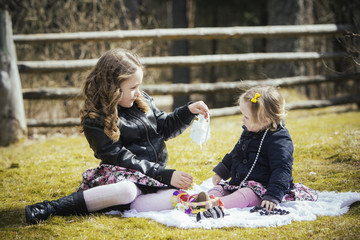 Sisters playing outdoors