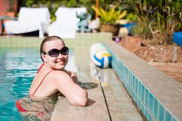 Beautiful  woman smiling in a swimming pool