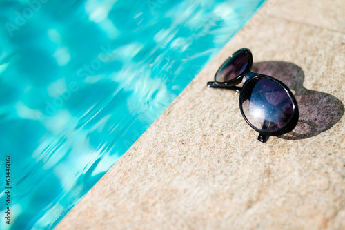 Sunglasses near swimming pool