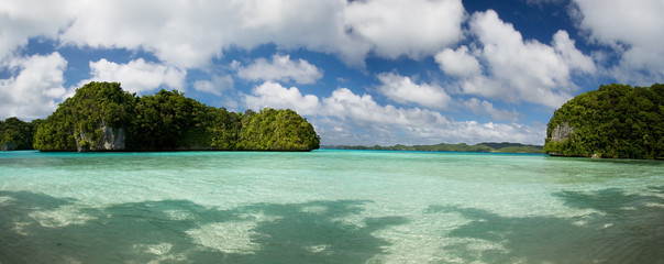 Cobalt blue water and blue sky with clouds in Palau