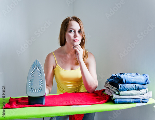 thoughtful woman of doing the ironing. Housework