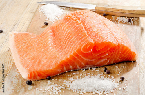 Salmon on a wooden platter . Selective focus