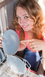 young woman putting dishes in the dishwasher