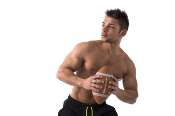 Muscular american football player shirtless ready to throw ball