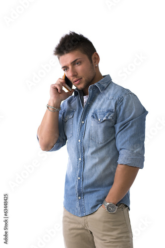 Handsome young man talking on cell phone (mobile), isolated