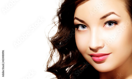 Pretty girl with long hair, white background, copyspace.