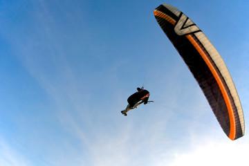 Paraglider in flight, Italy