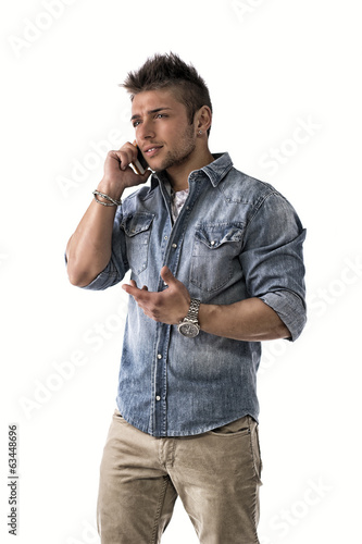 Handsome upset young man talking on cell phone (mobile)