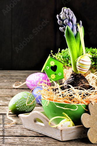 Easter setting with hyacinth and decorative eggs