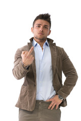Handsome young man doing 'screw you' sign with middle finger