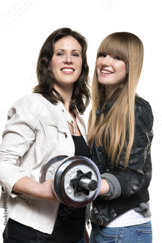 Two women with silver dumbbell