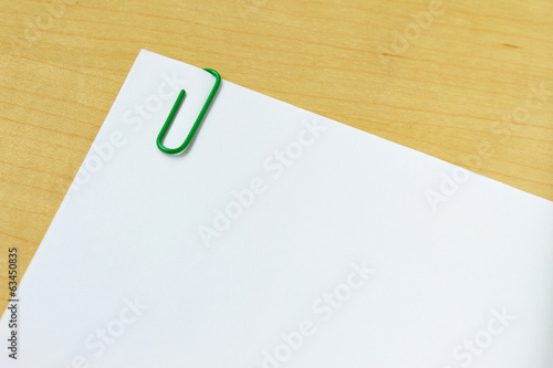 paper with paper clip isolated on white