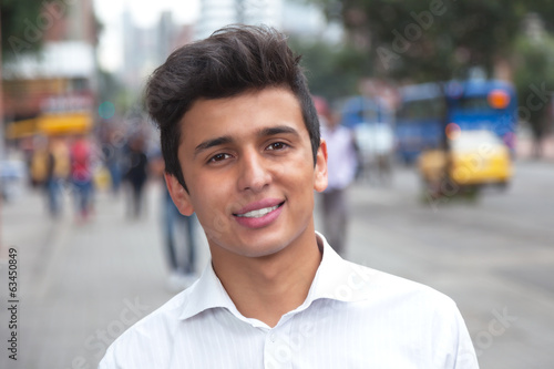 Attractive brazilian student in the city laughing at camera