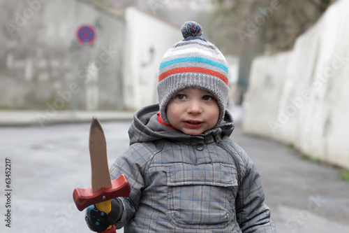 Boy with a wooden dagger