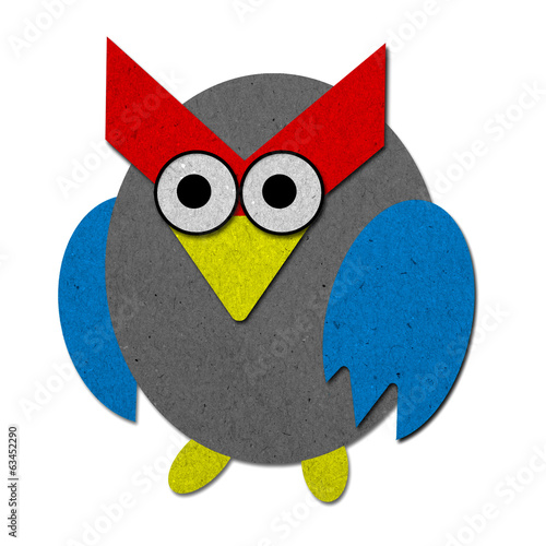 Owl made from recycled paper background